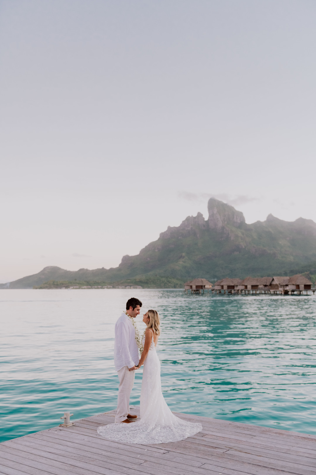 Couple destination wedding in Bora Bora on a dock by the ocean