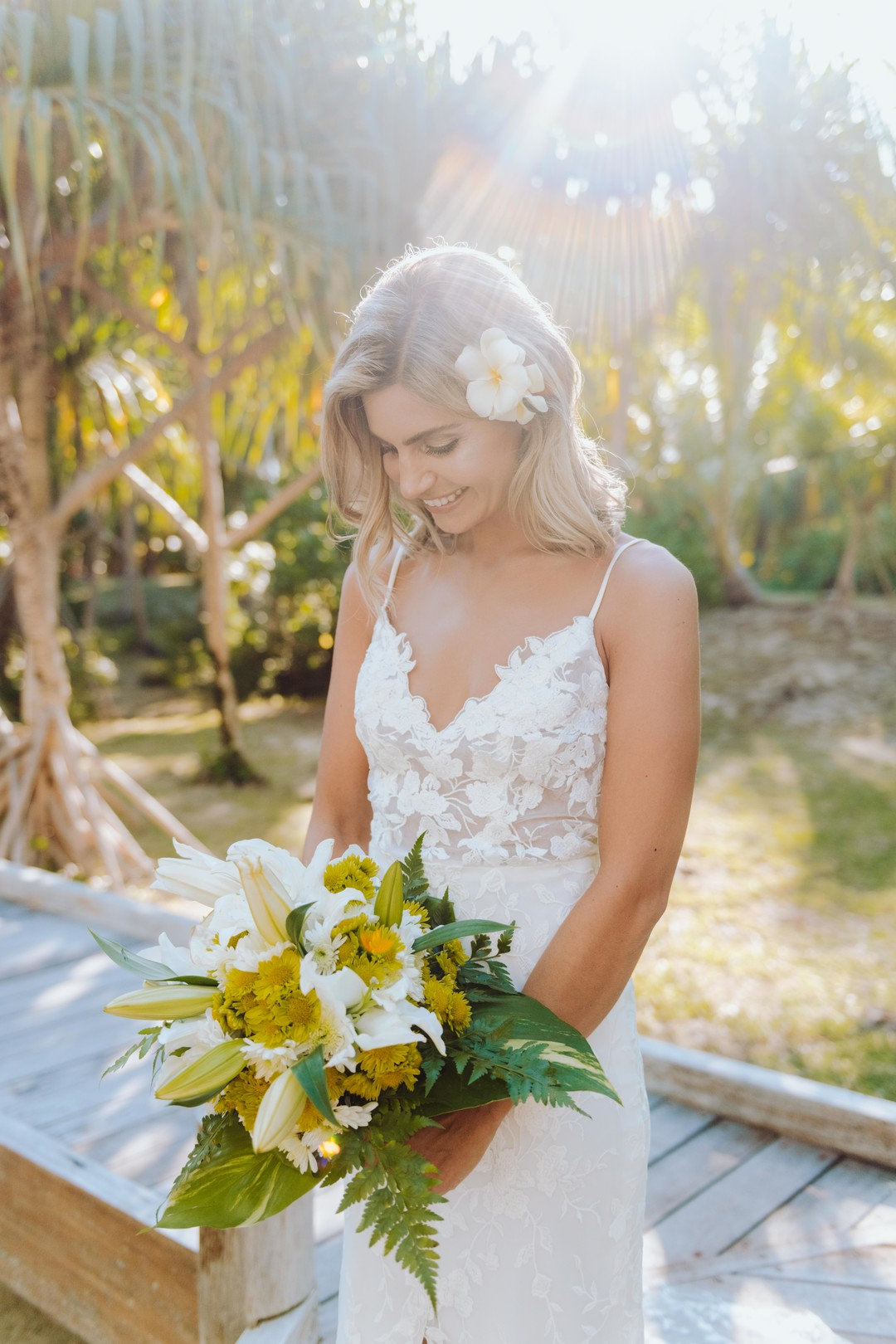 Closeup of Bride in Bora Bora with a white plumeria in her hair