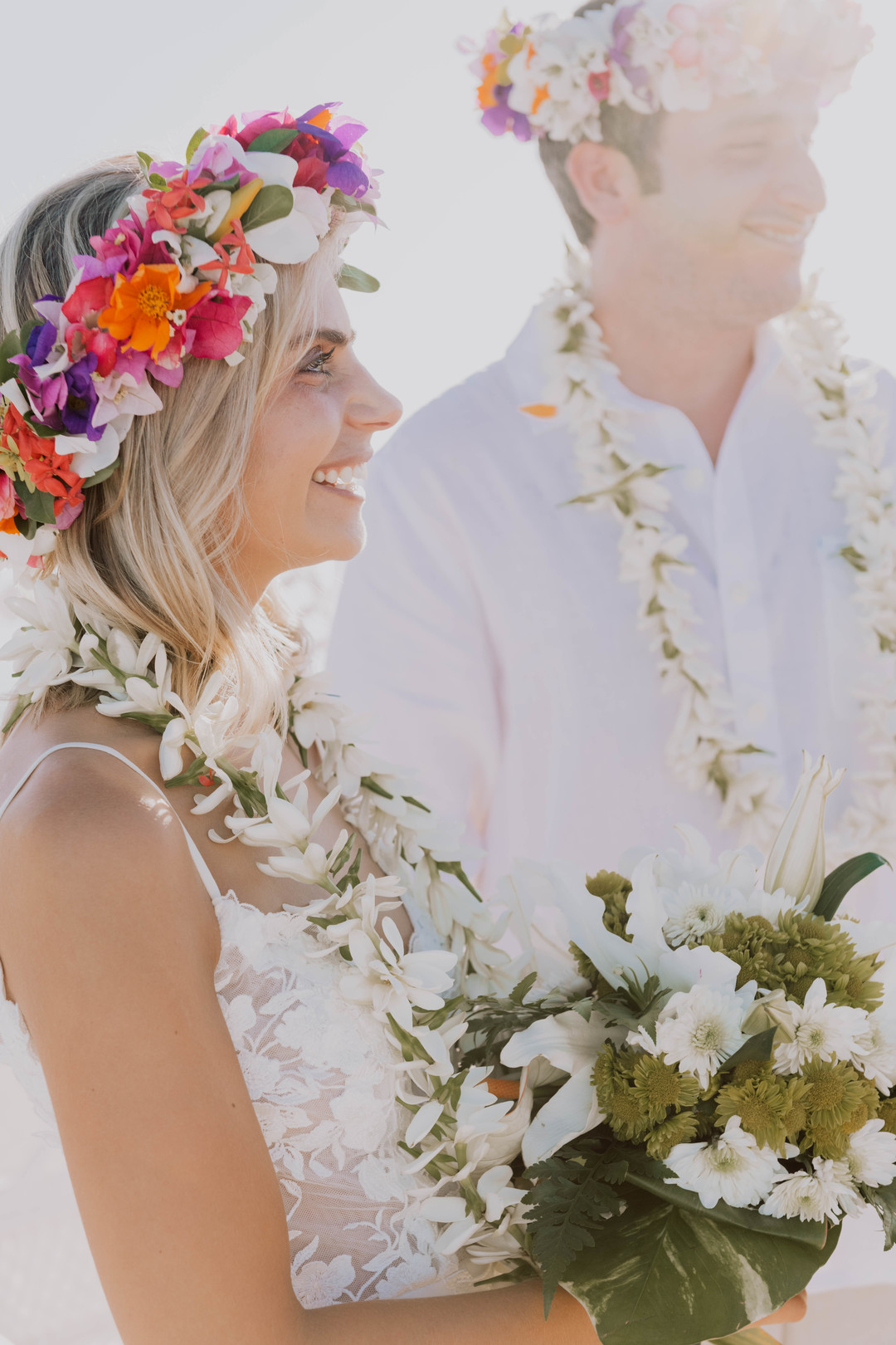 bride smiling during ceremony with a colorful flower crown
