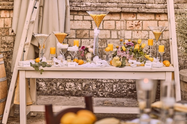 candy table with martini glasses and yellow candy