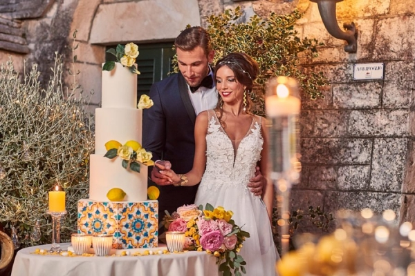 Bride and groom cutting a lemon cake in italy