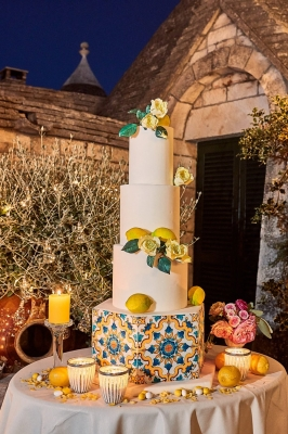white wedding cake decorated with lemons