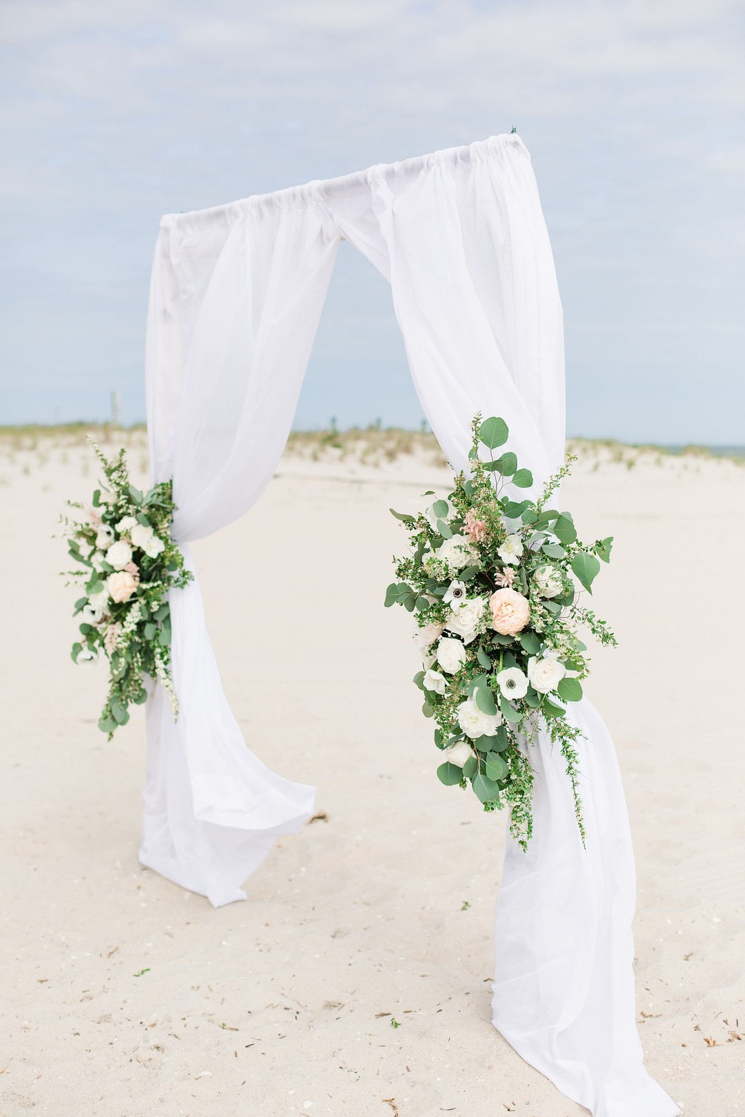 ceremony arbor decorated with white anemones