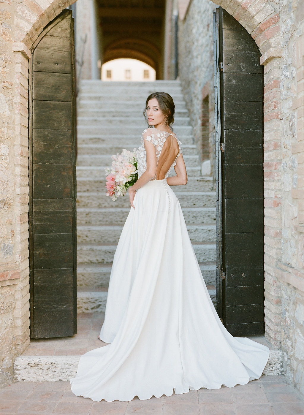 open back wedding dress with floral appliques and an illusion top