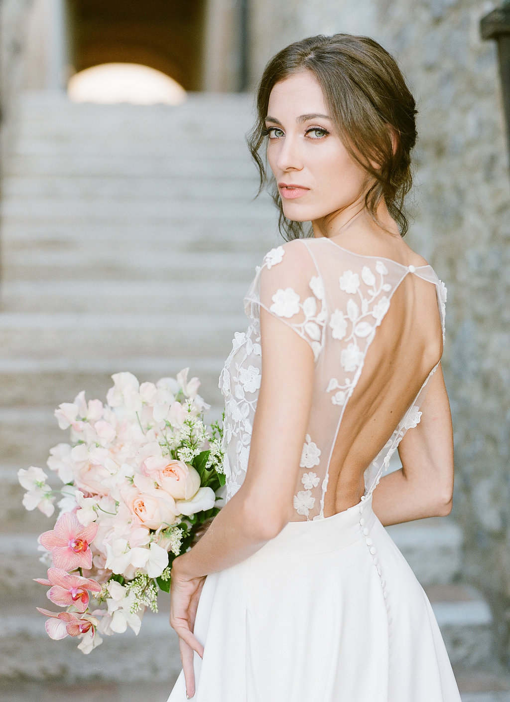 stunning bride with open back gown and illusion bodice