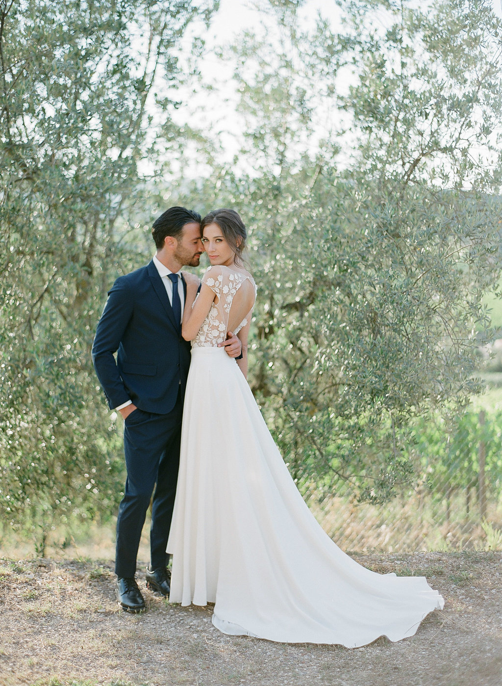 bride and groom posing in a tuscan vineyard