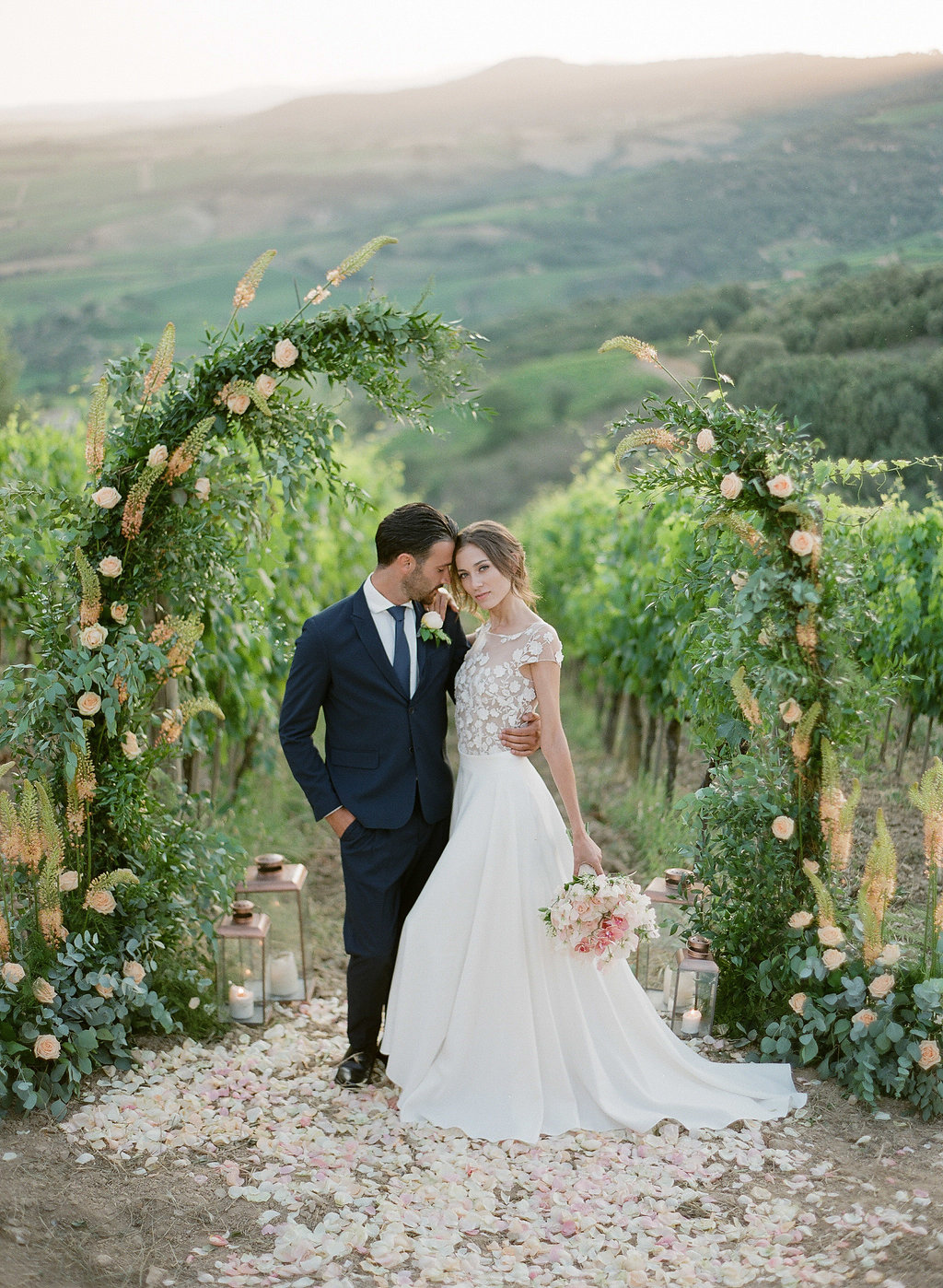 bride and groom in front of gorgeous tuscan backdrop