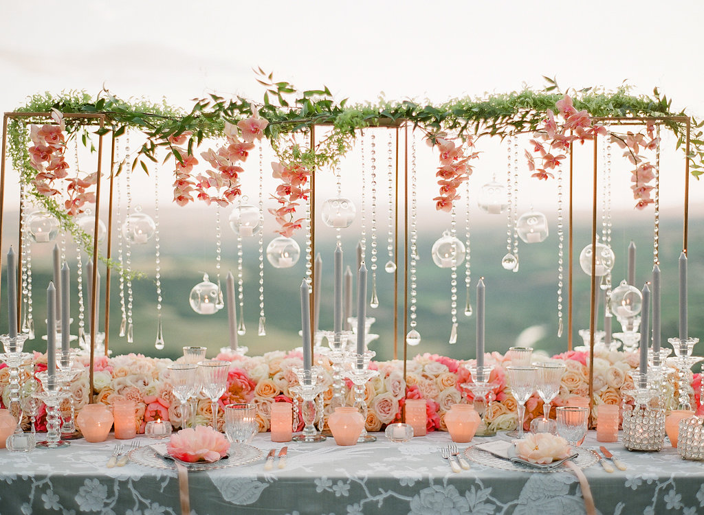 coral and peach wedding decor with hanging glass orbs