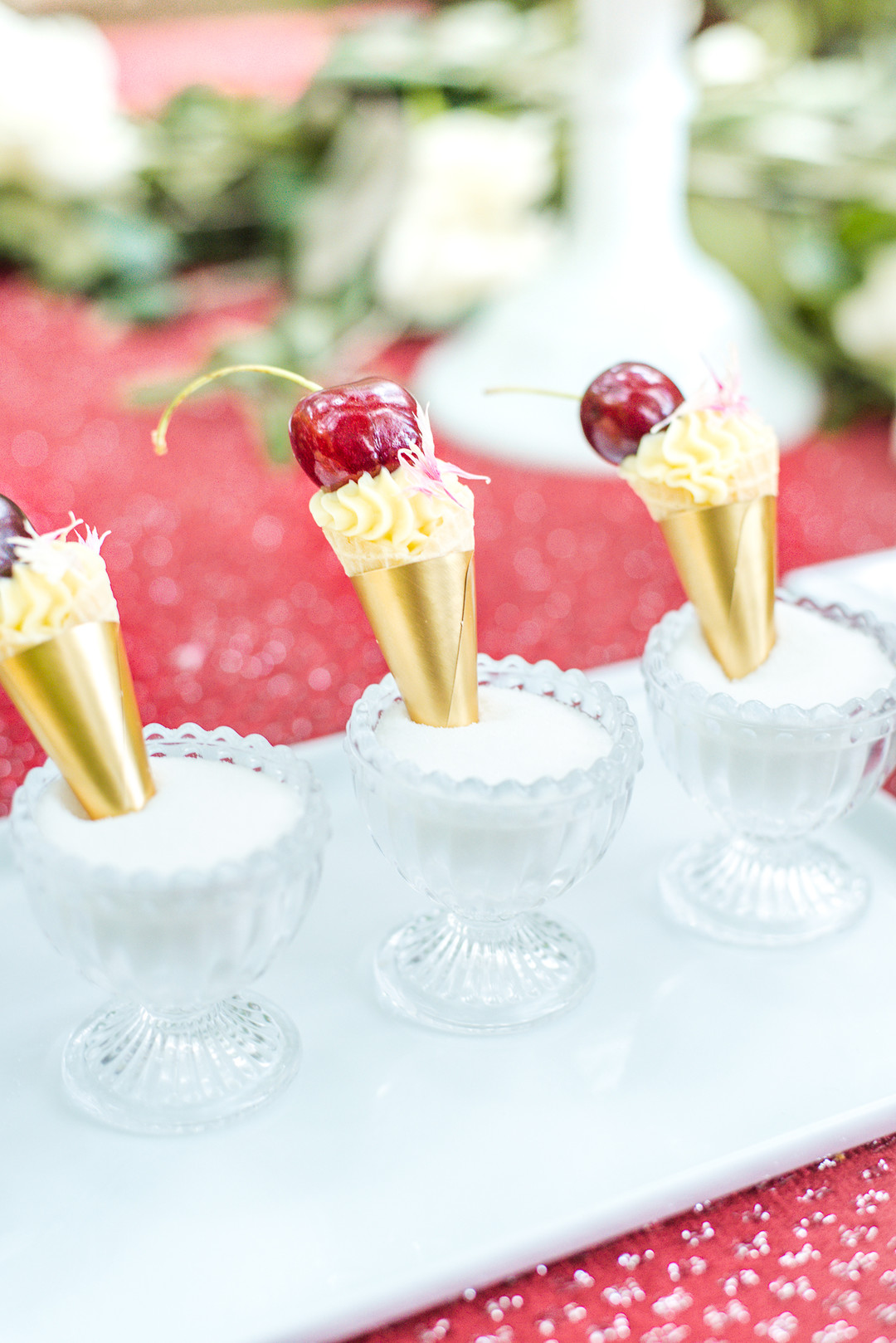 gold covered mini desserts with a cherry on top
