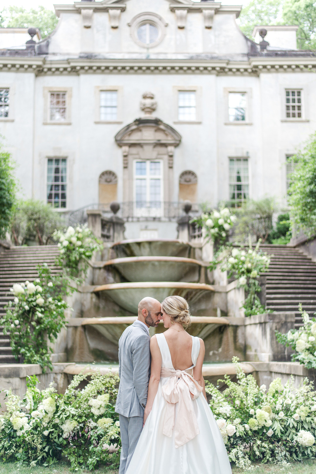 bride and groom standing in front of the Swan House in Atlanta