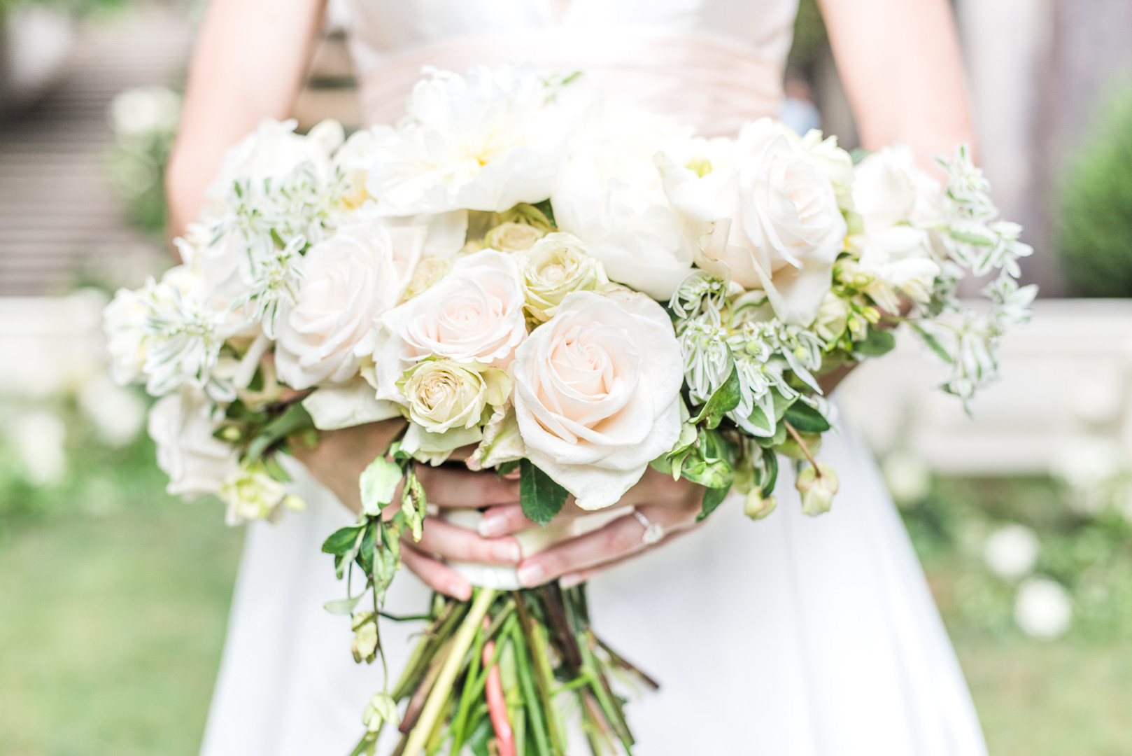 bride holing a large rose bouquet
