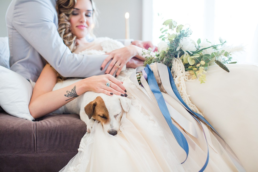 bride with cute pup and blue ribbon bouquet