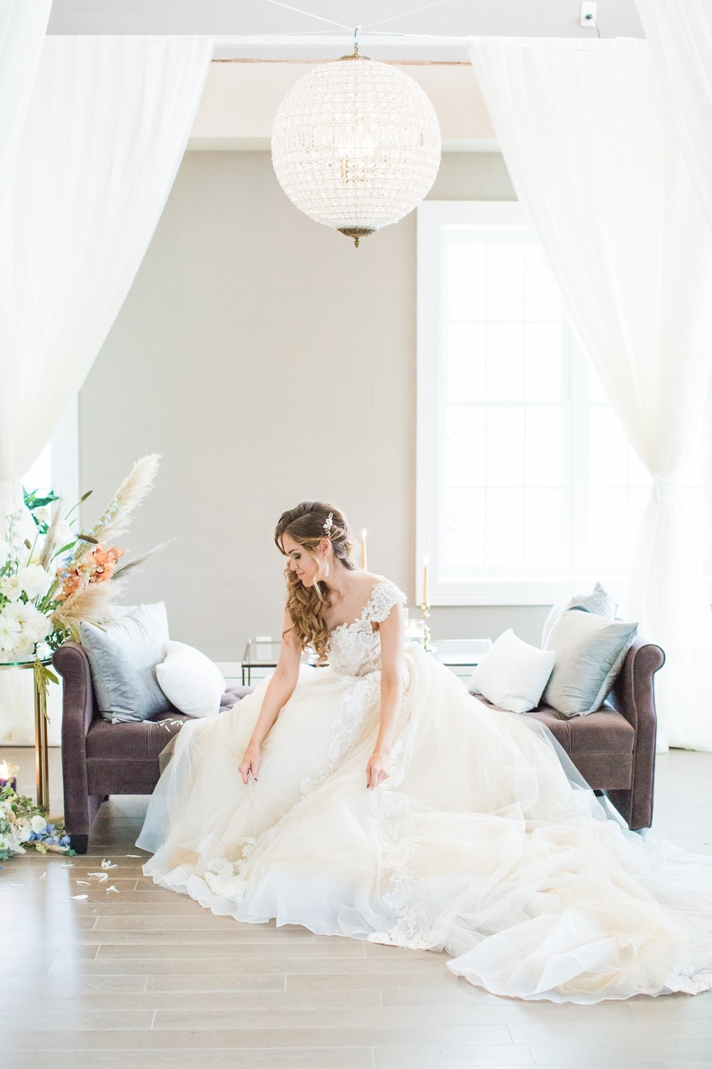 bride in a beautiful ball gown dress on an aubergine chaise