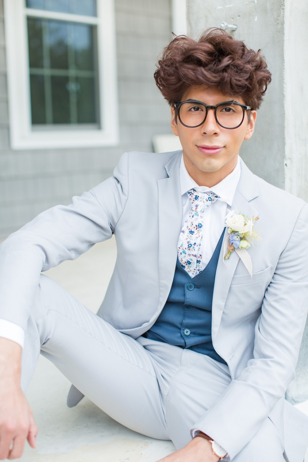 groom posing in a classic blue suit