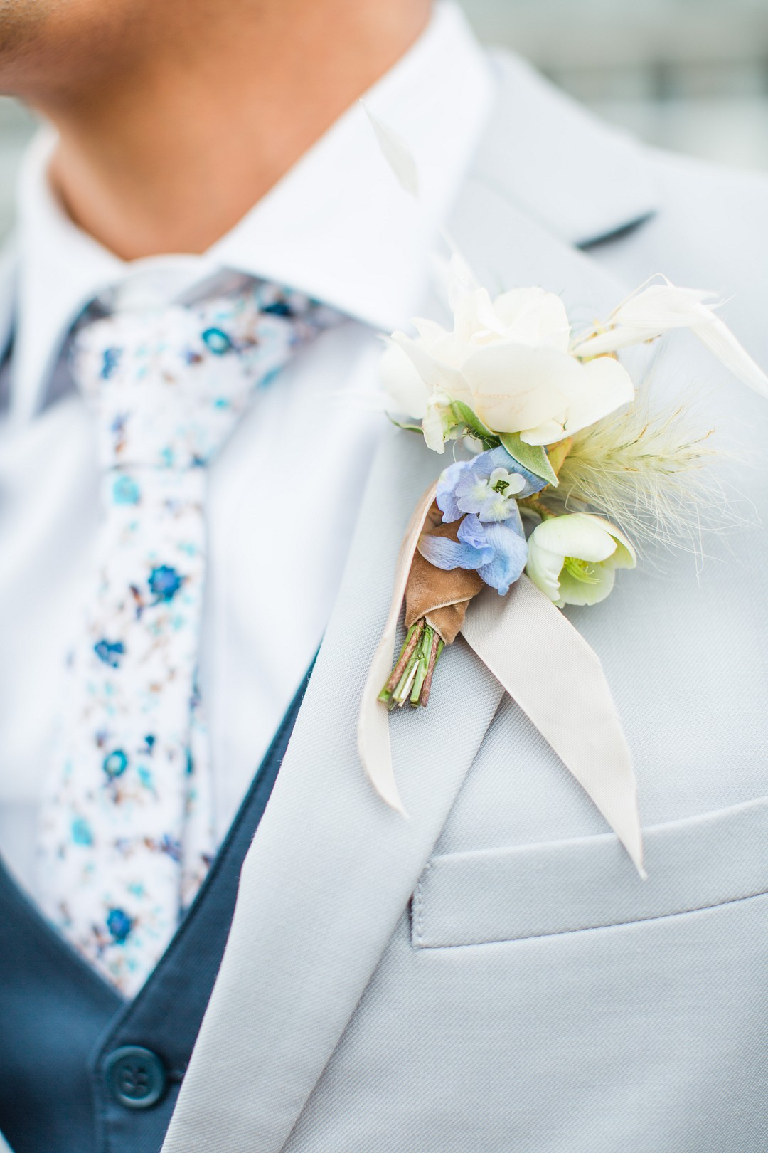 classic blue boutonniere and tie