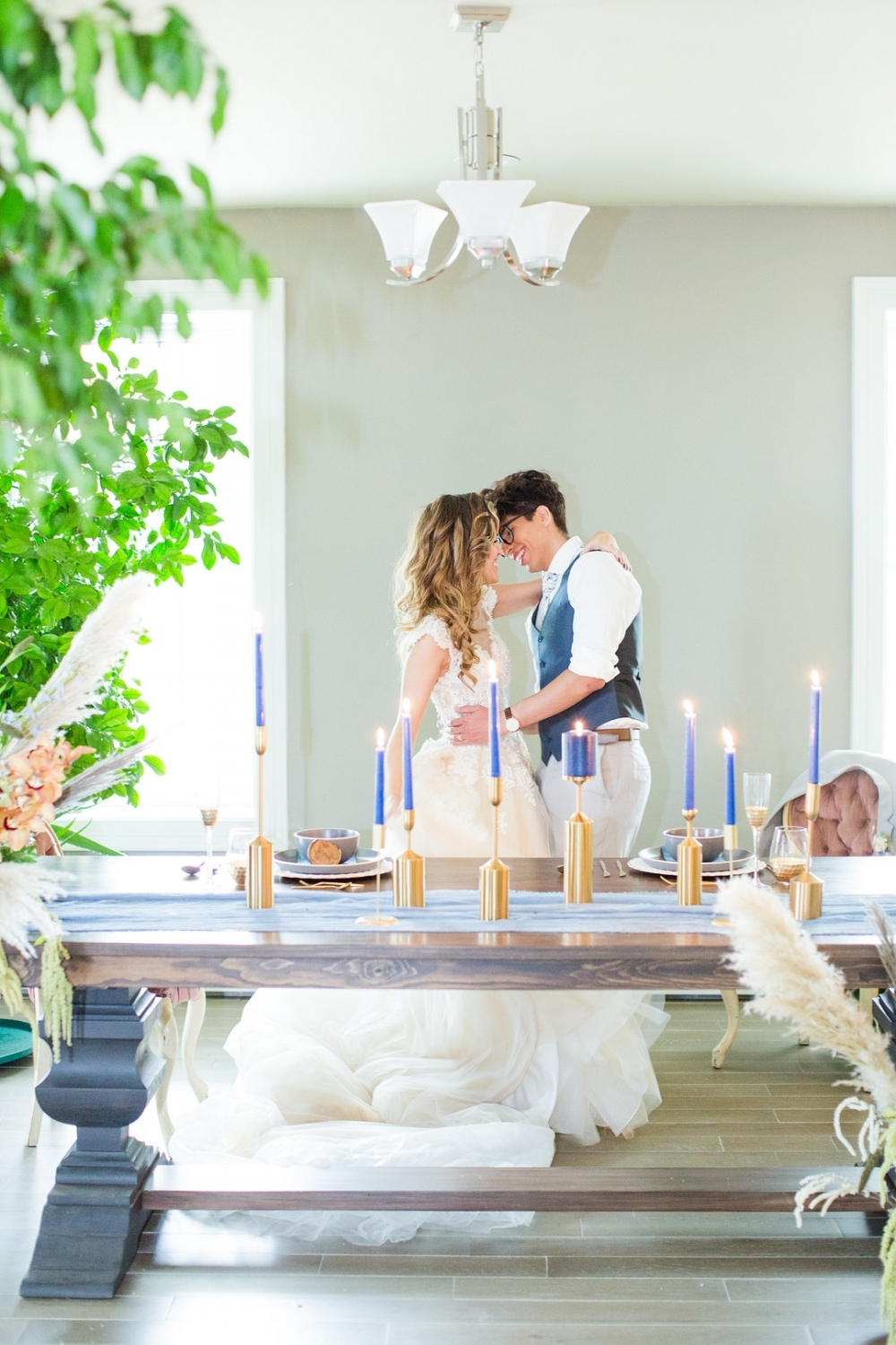 bride and groom behind a candleit table