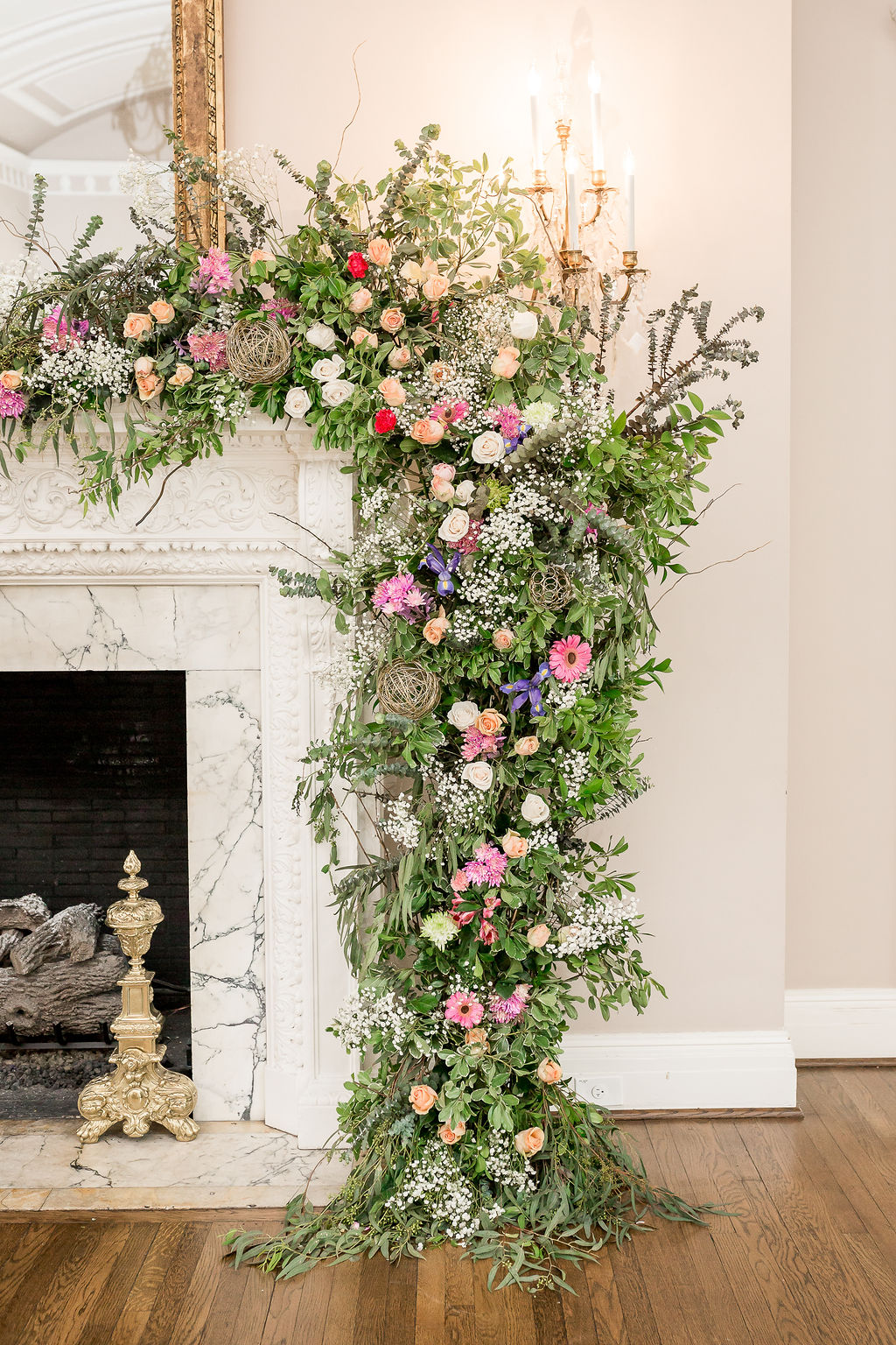 large and colorful floral installation on a fireplace