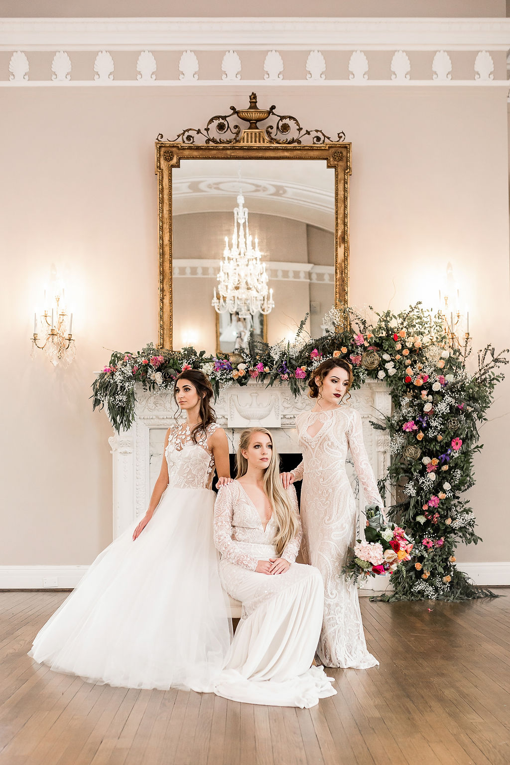 gorgeous brides in front of a baroque styled fireplace