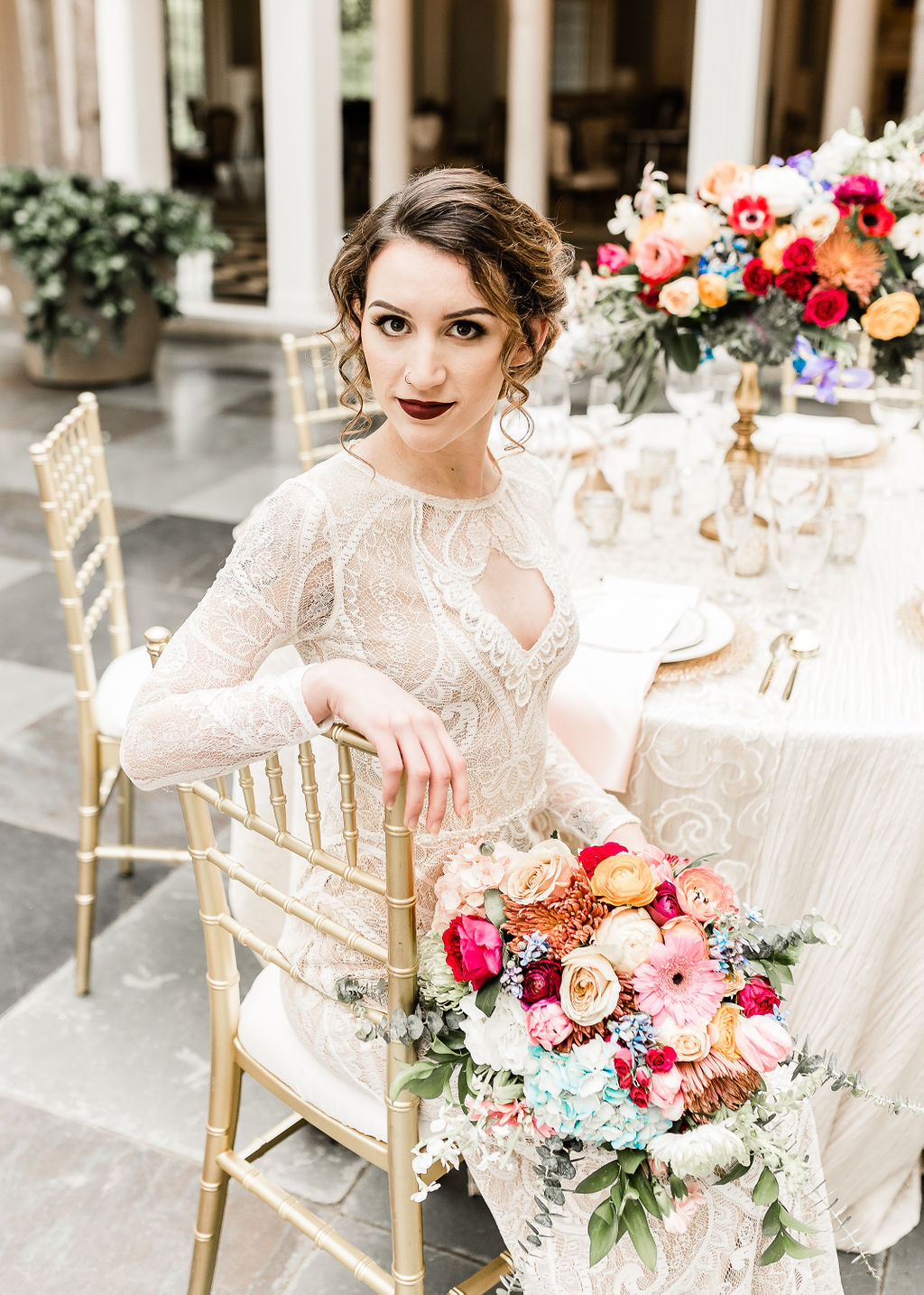 bride with dark red lipstick and colorful flowers