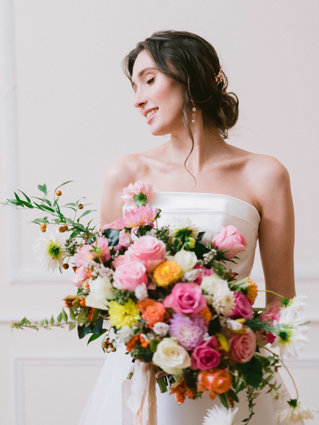 bride holding a colorful bouquet
