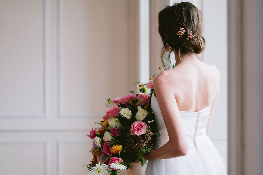 bride walking with a large bouquet