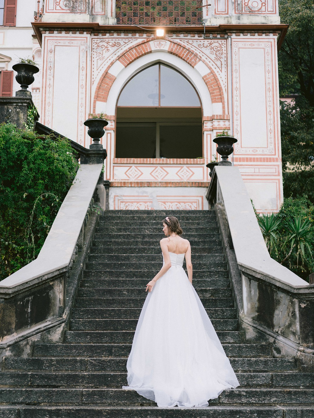 bride walking up the villa staircase