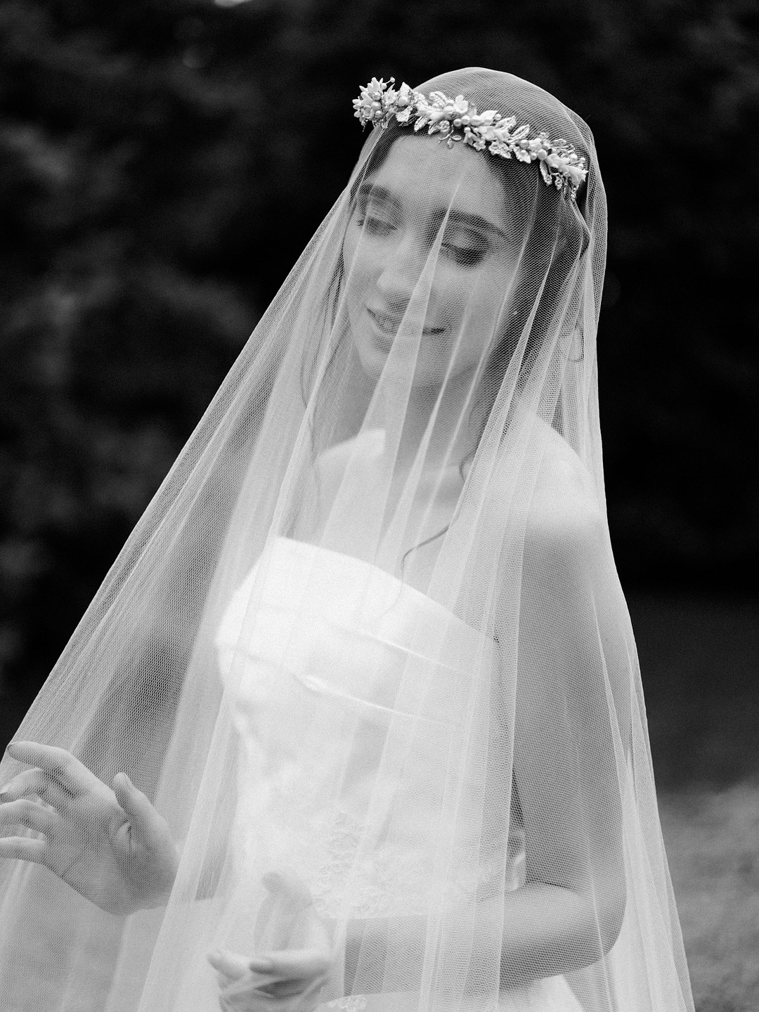 black and white photo of a bride and her veil
