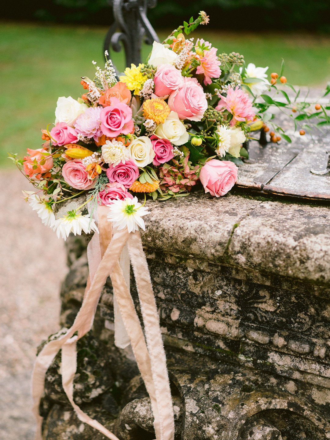 spring inspired bride bouquet with peach ribbons