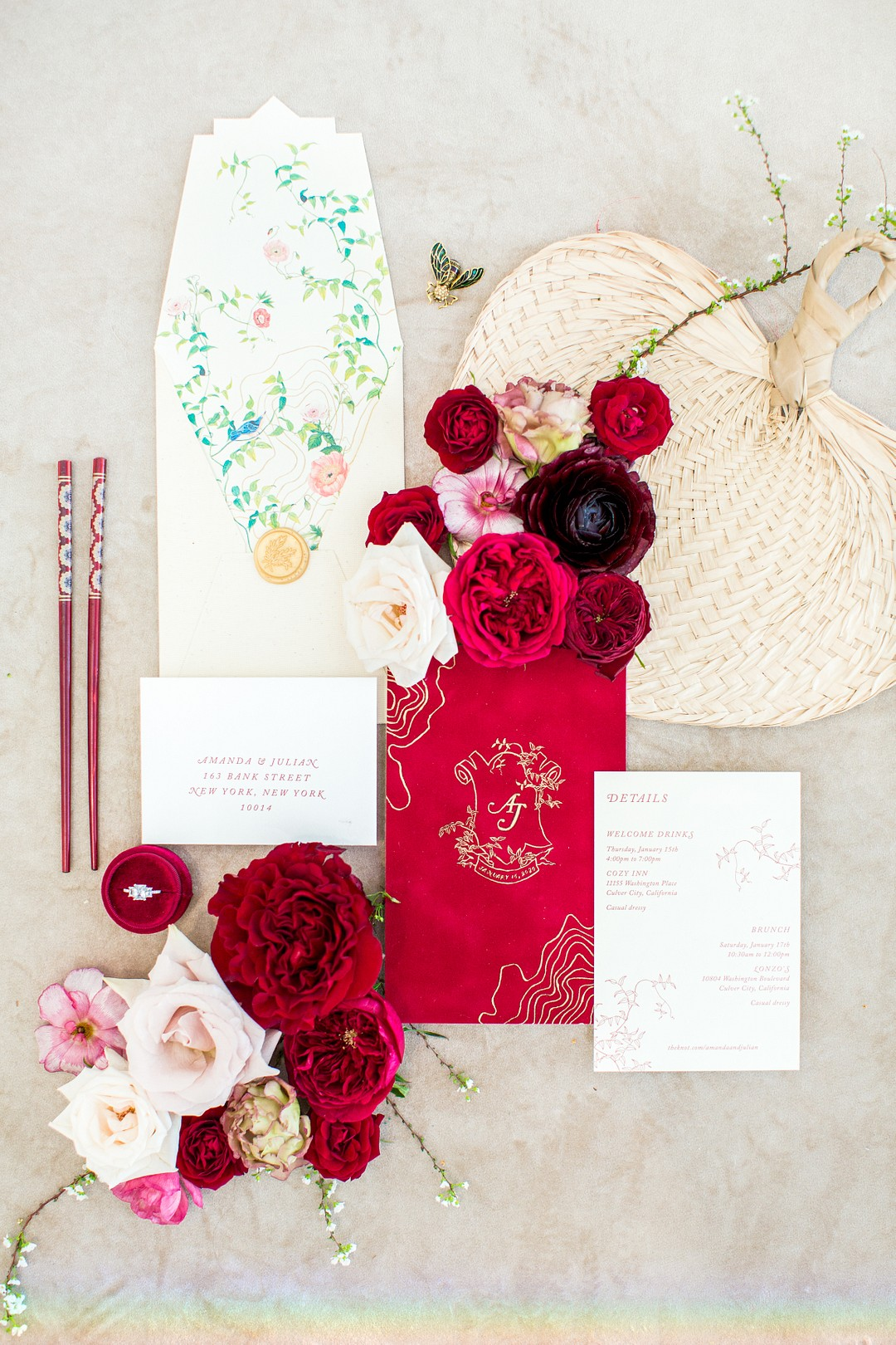 red chopstickd, red vow book and red roses for a chinese new year wedding