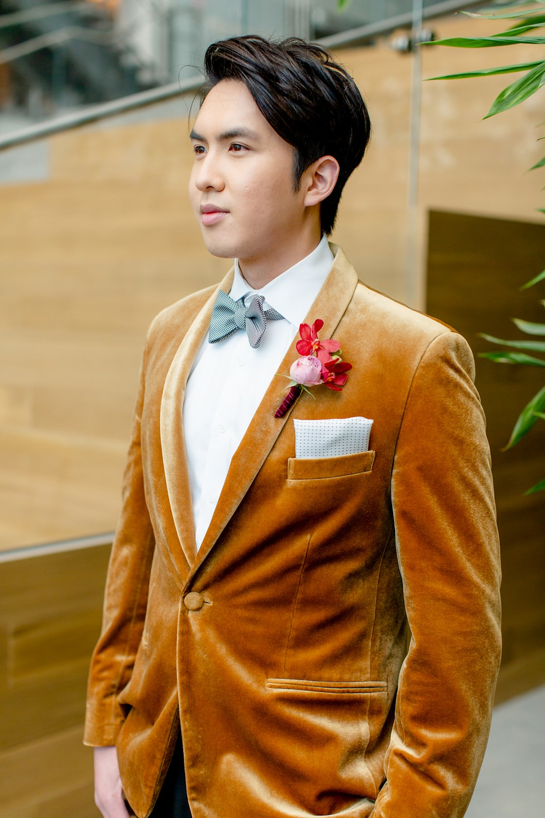 groom wearing a velvet mustard jacket