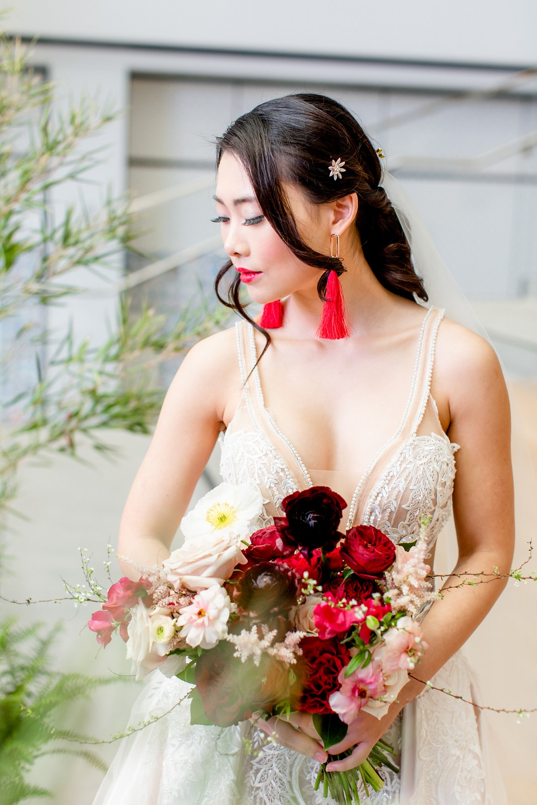 bride wearing red tassel earrings