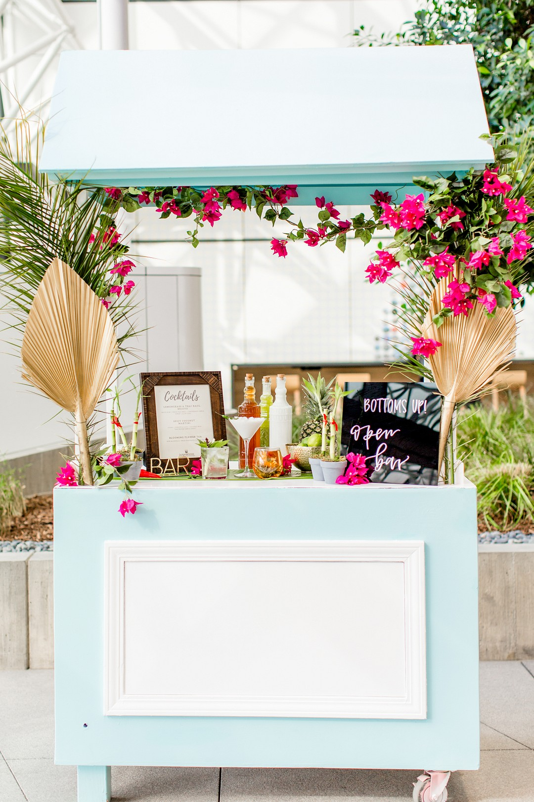 wedding bar cart covered in vibrant bougainvillea flowers