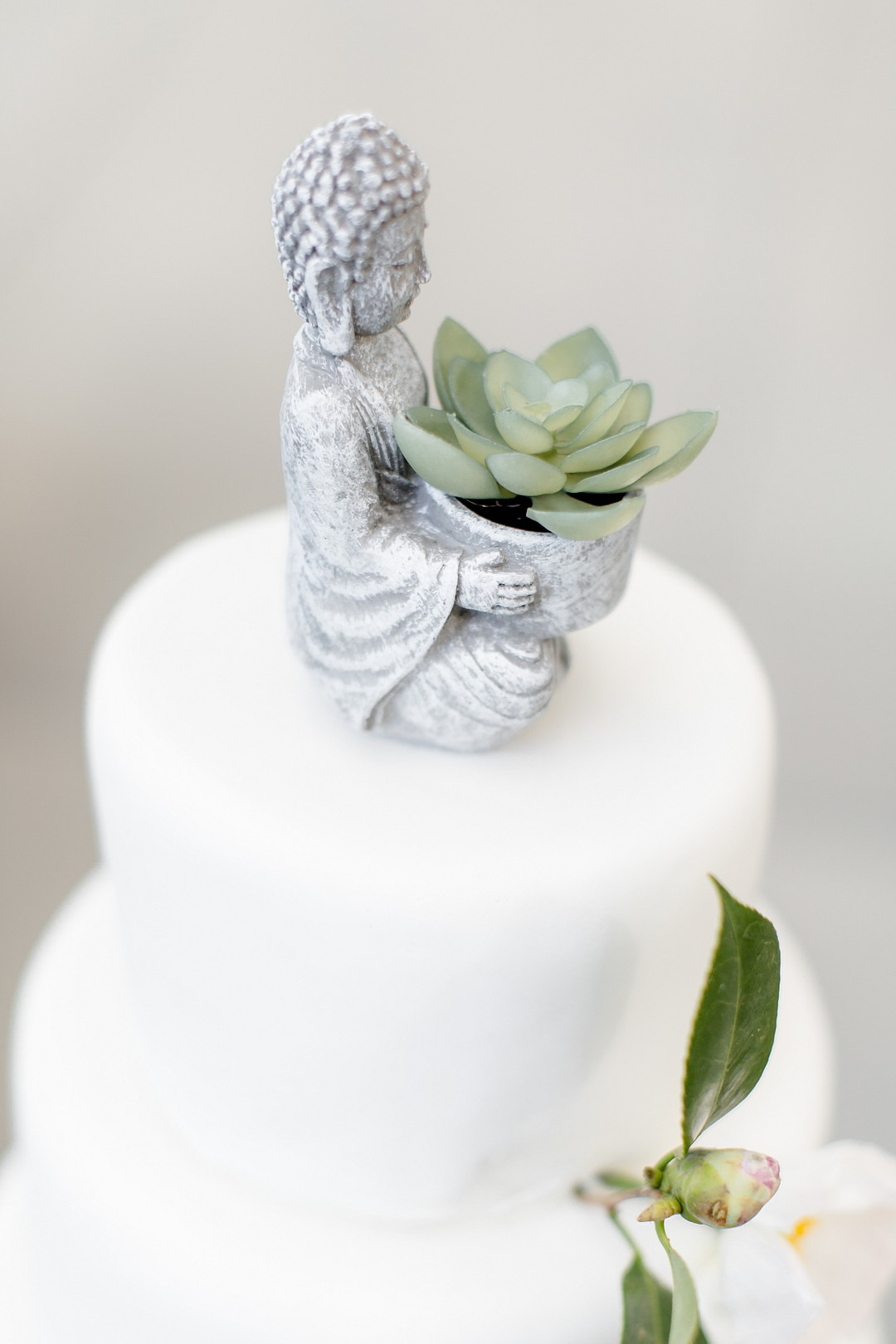 asian inspred cake topper monk holding a succulent