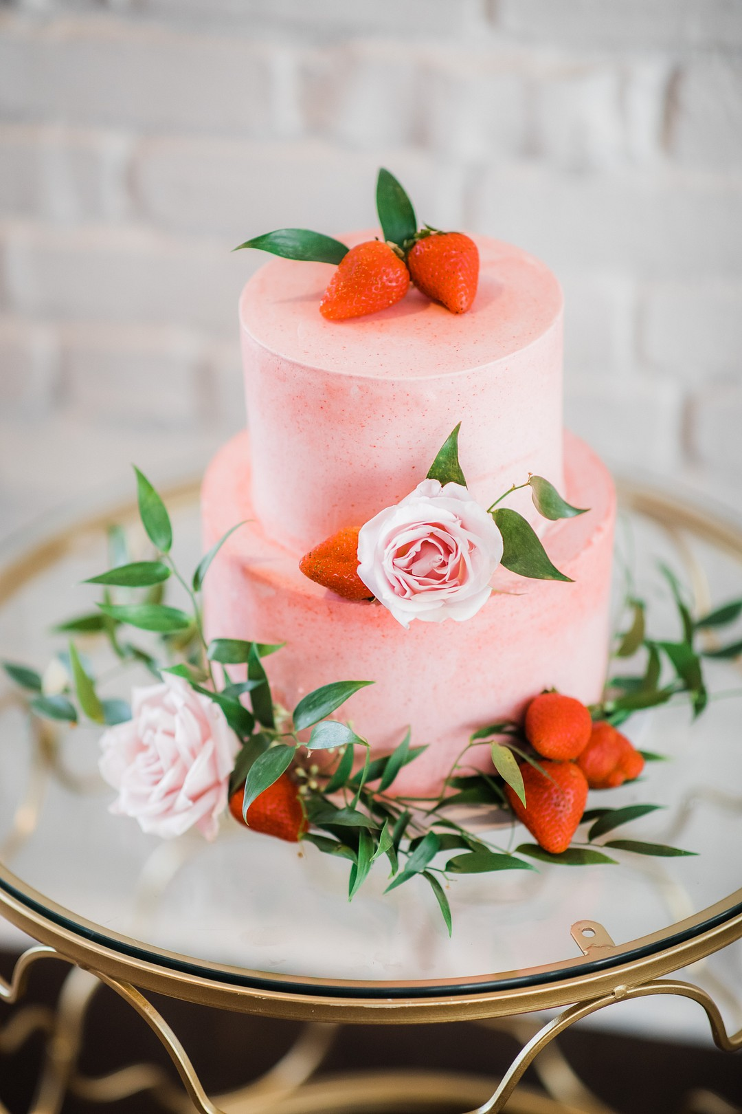 pink and strawberry frosted wedding cake