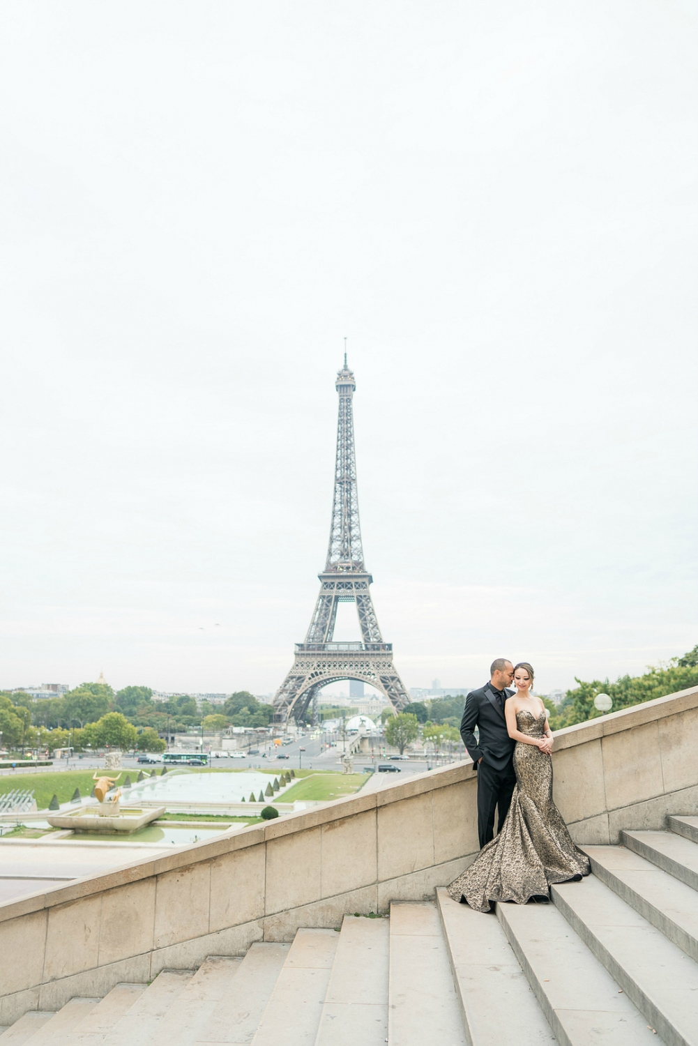 wedding portraits in front of Eiffel tower with gold dress