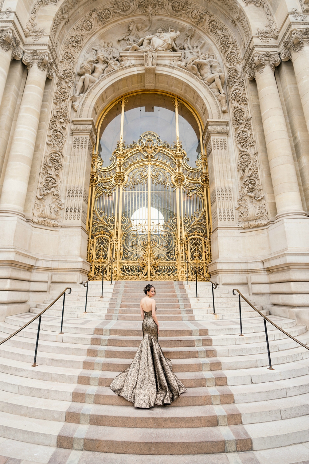 gold dress in front of french golden gate