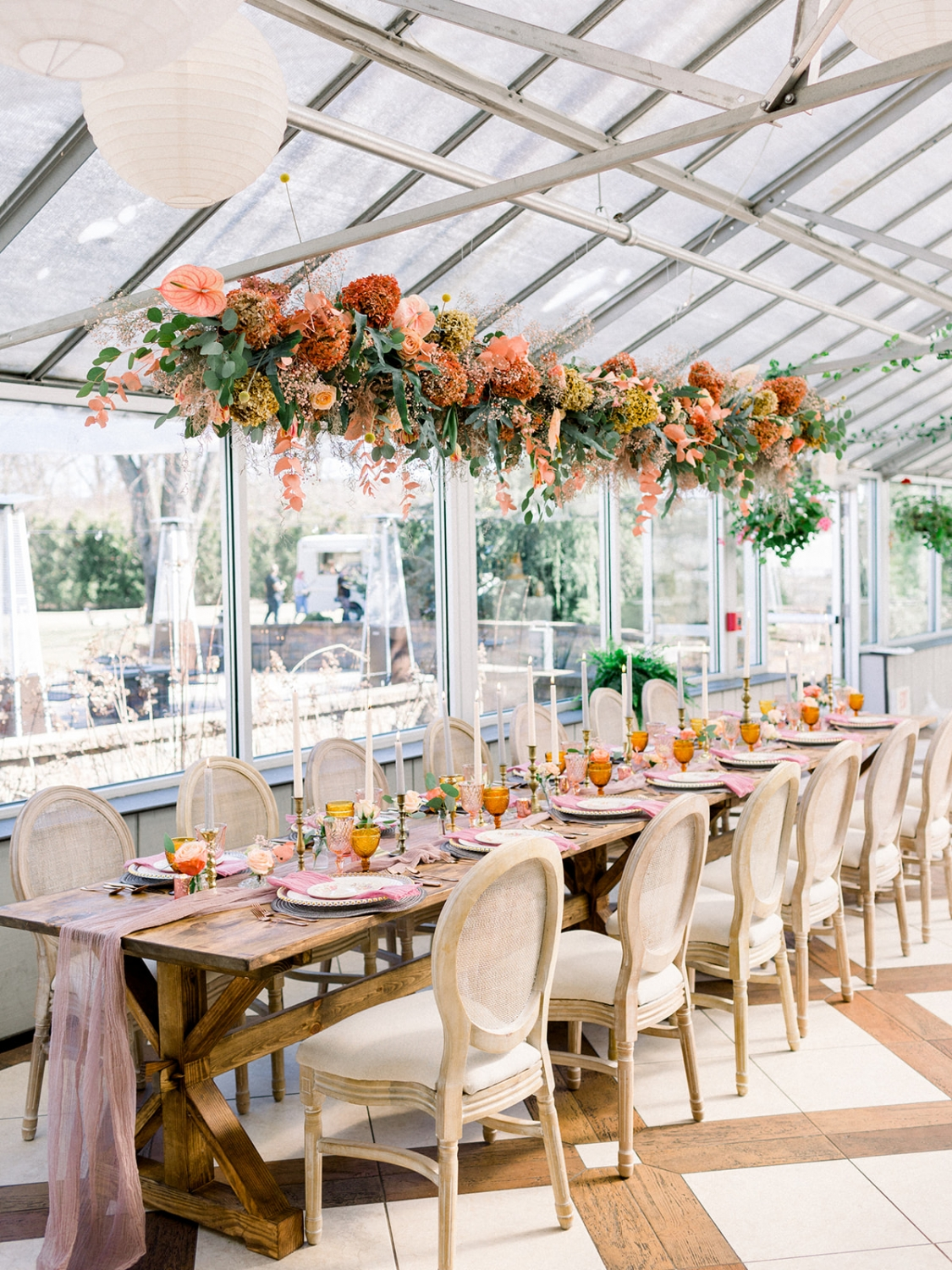 Above the table hung a floral installation filled with the same florals as the ceremony and also included tinted Plumosa, Eucalyptus, and hand-painted dried Paniculata Hydrangea!