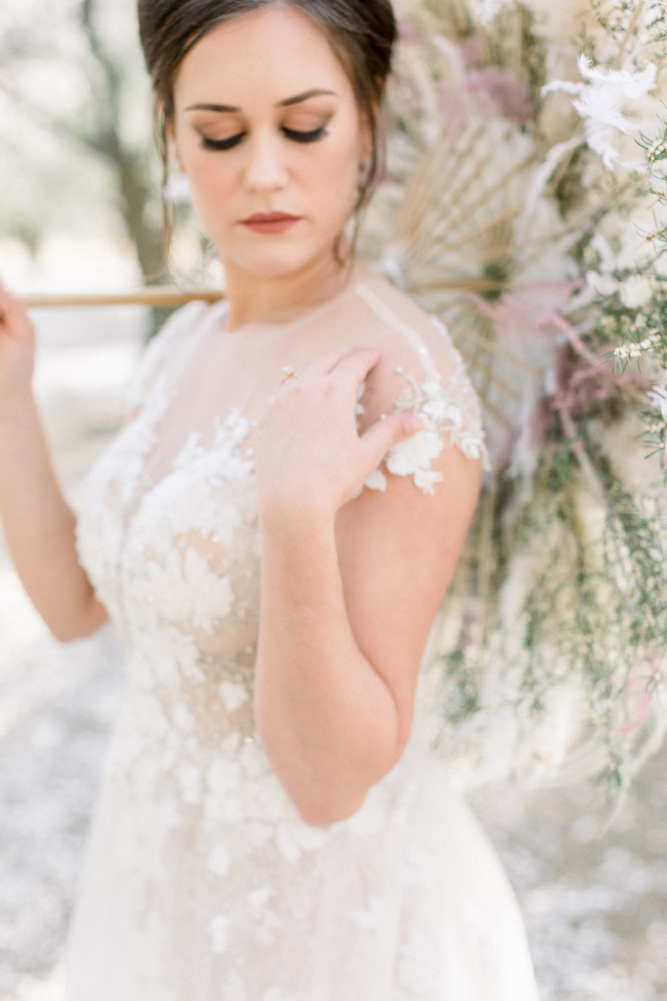 bride holding a fresh flower umbrella