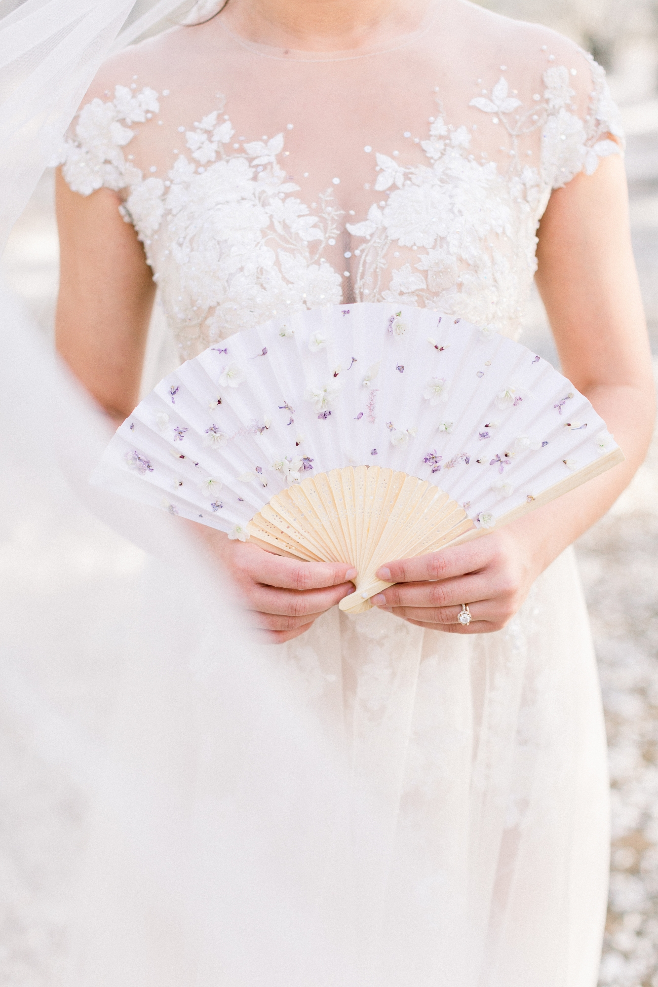 bride holding a japanese fan