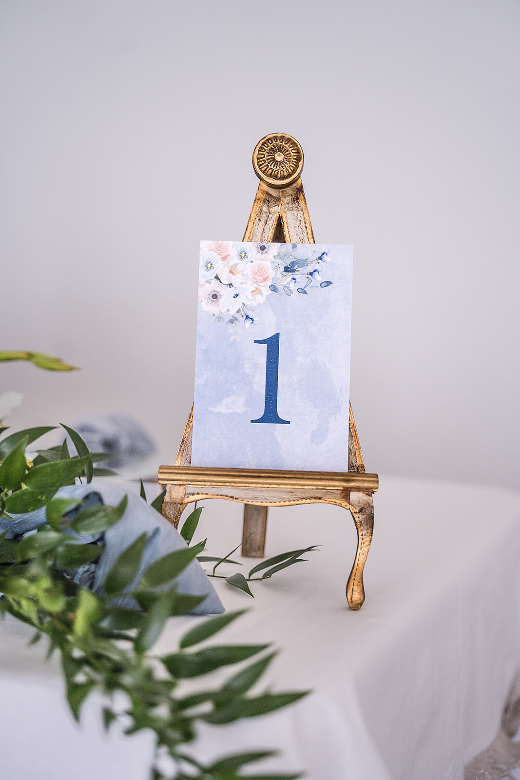 gold and blue easel place-card holder