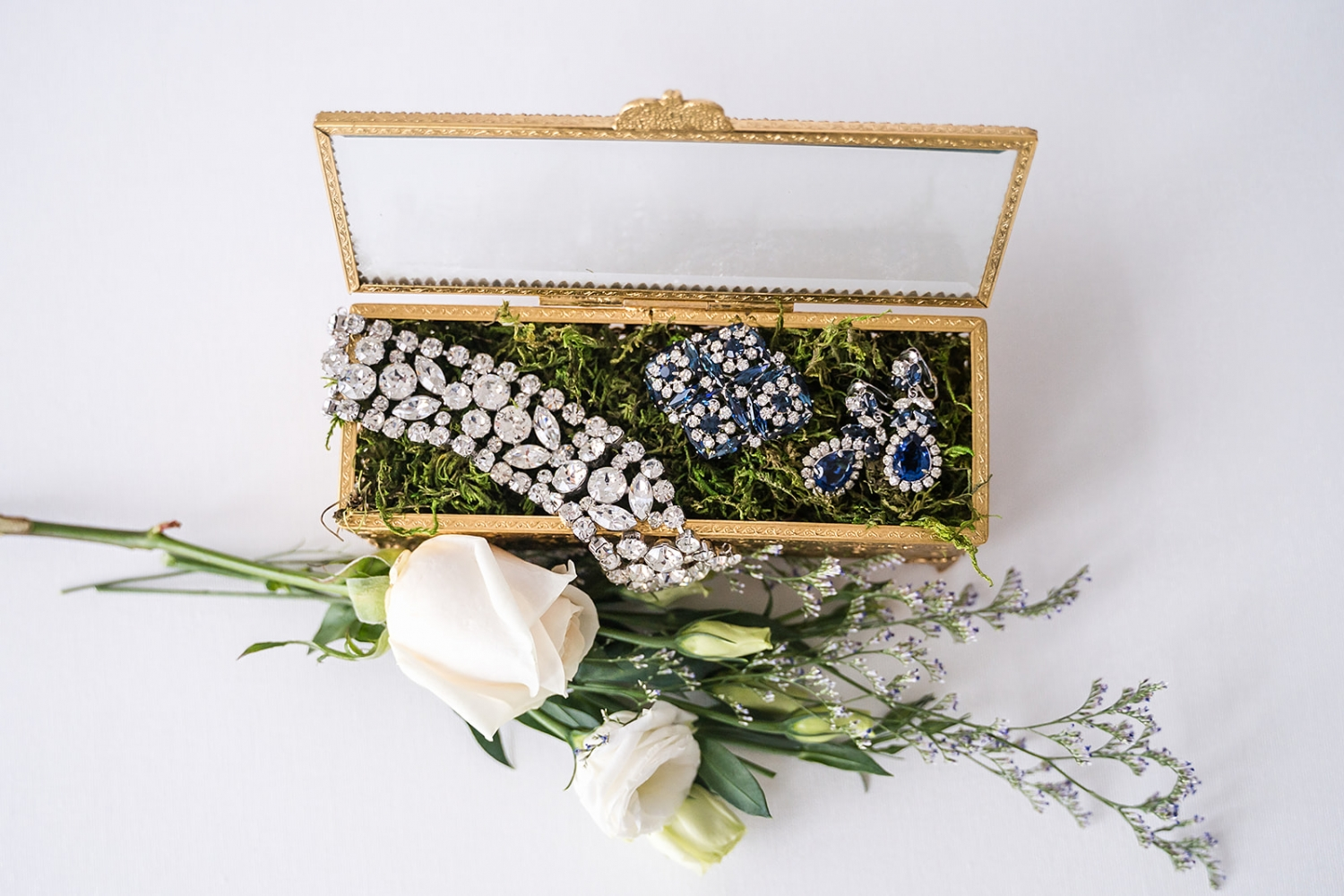bridal jewelry in a gold box with moss photo ideas
