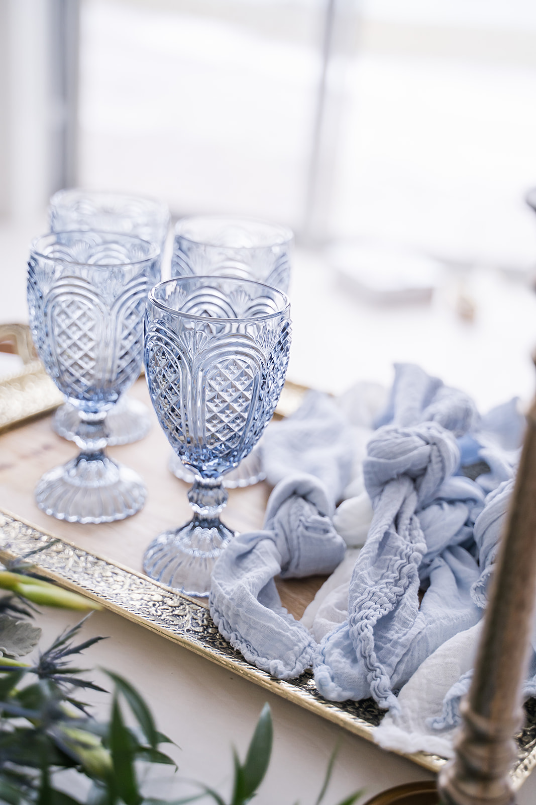 light blue goblets and a matching blue cheese cloth napkin