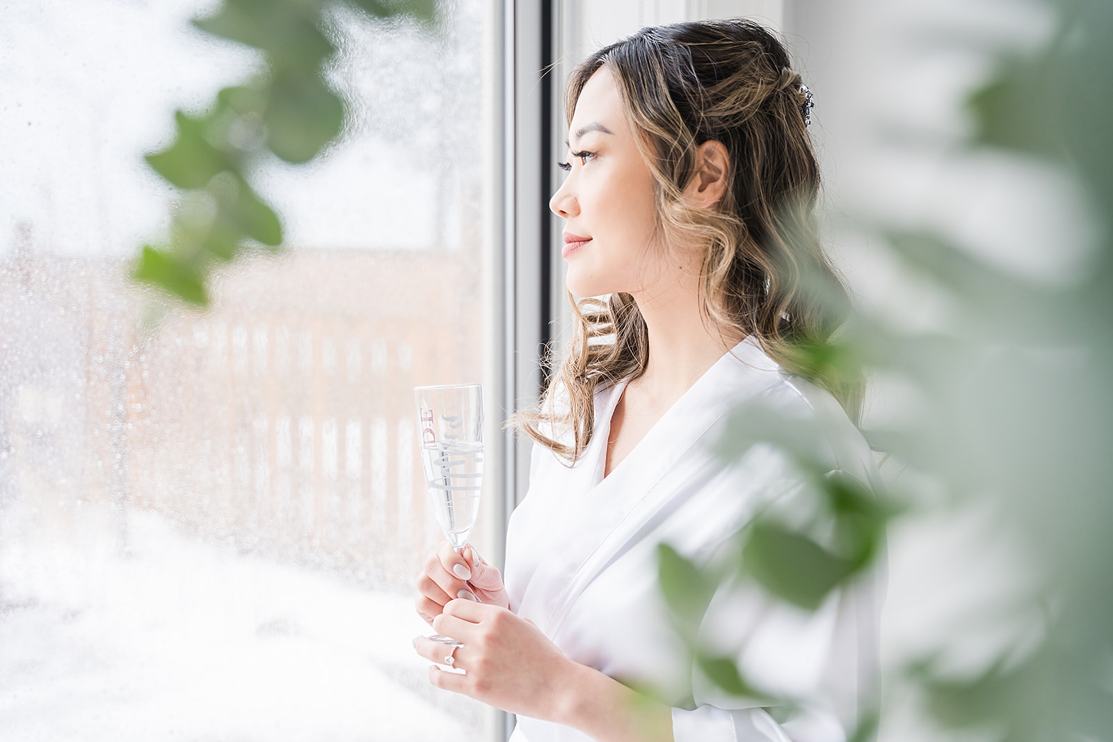 bride looking out the window and smiling