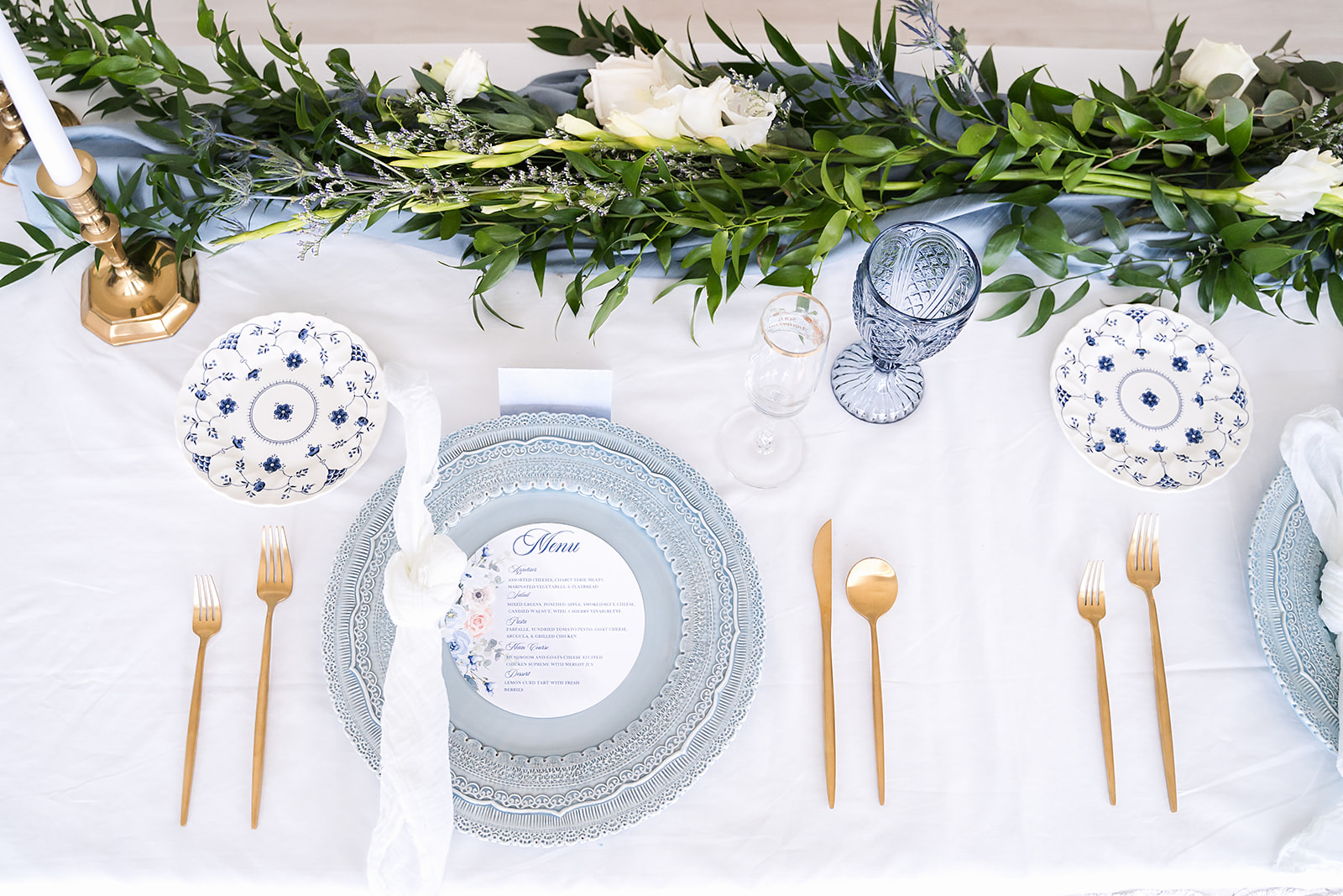 classic blue table decor inspo with a blue charger and goblets