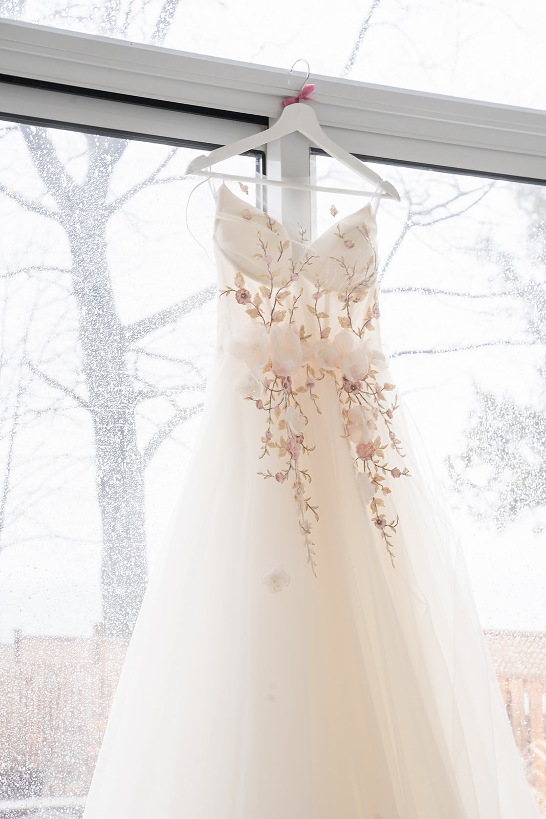 beautiful wedding gown with blush floral appliques