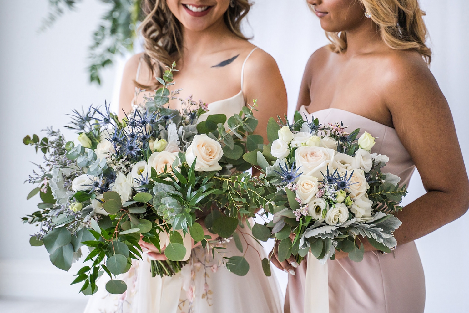 bride and maid of honor holding bouquets