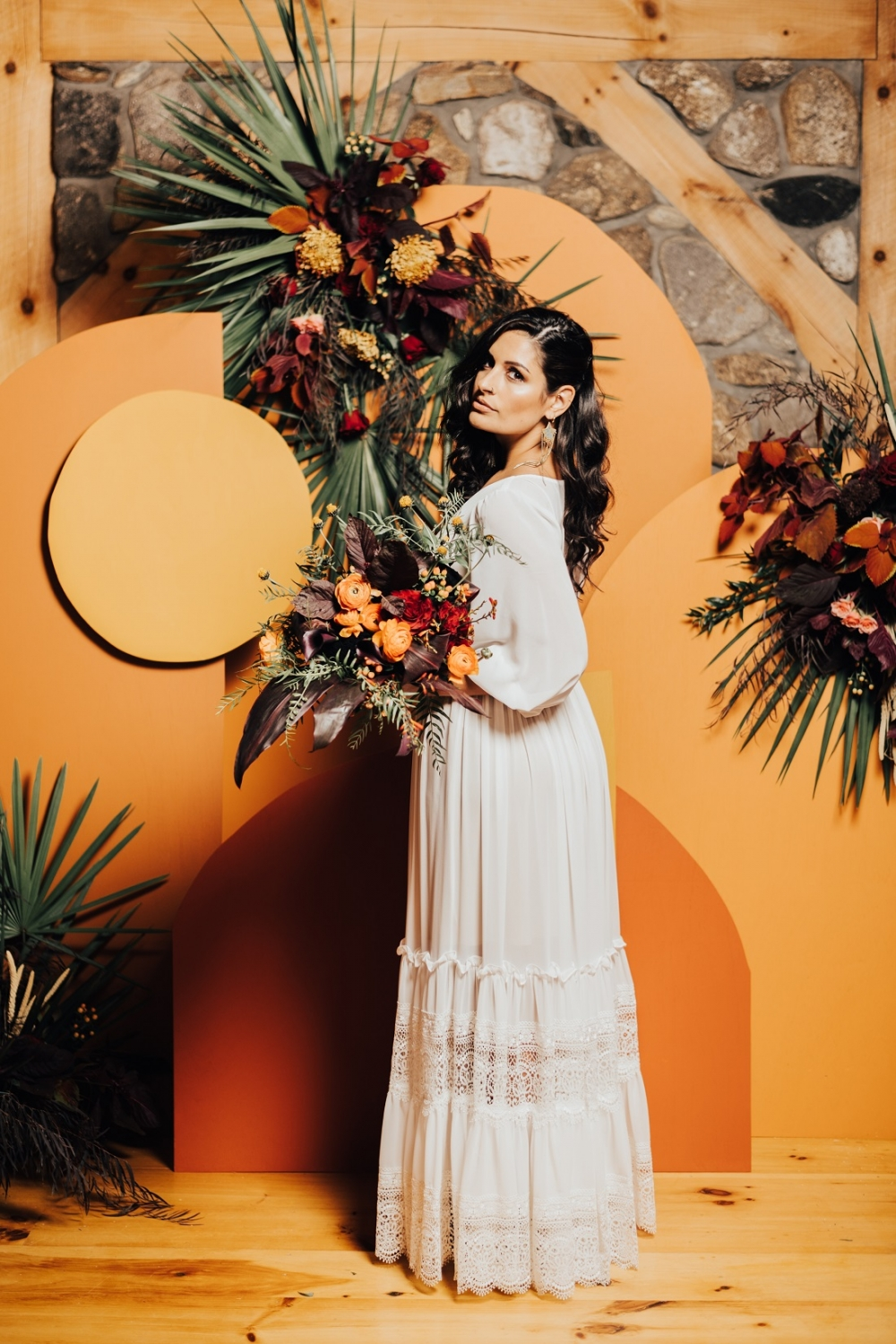 Bride in front of orange and yellow backdrop