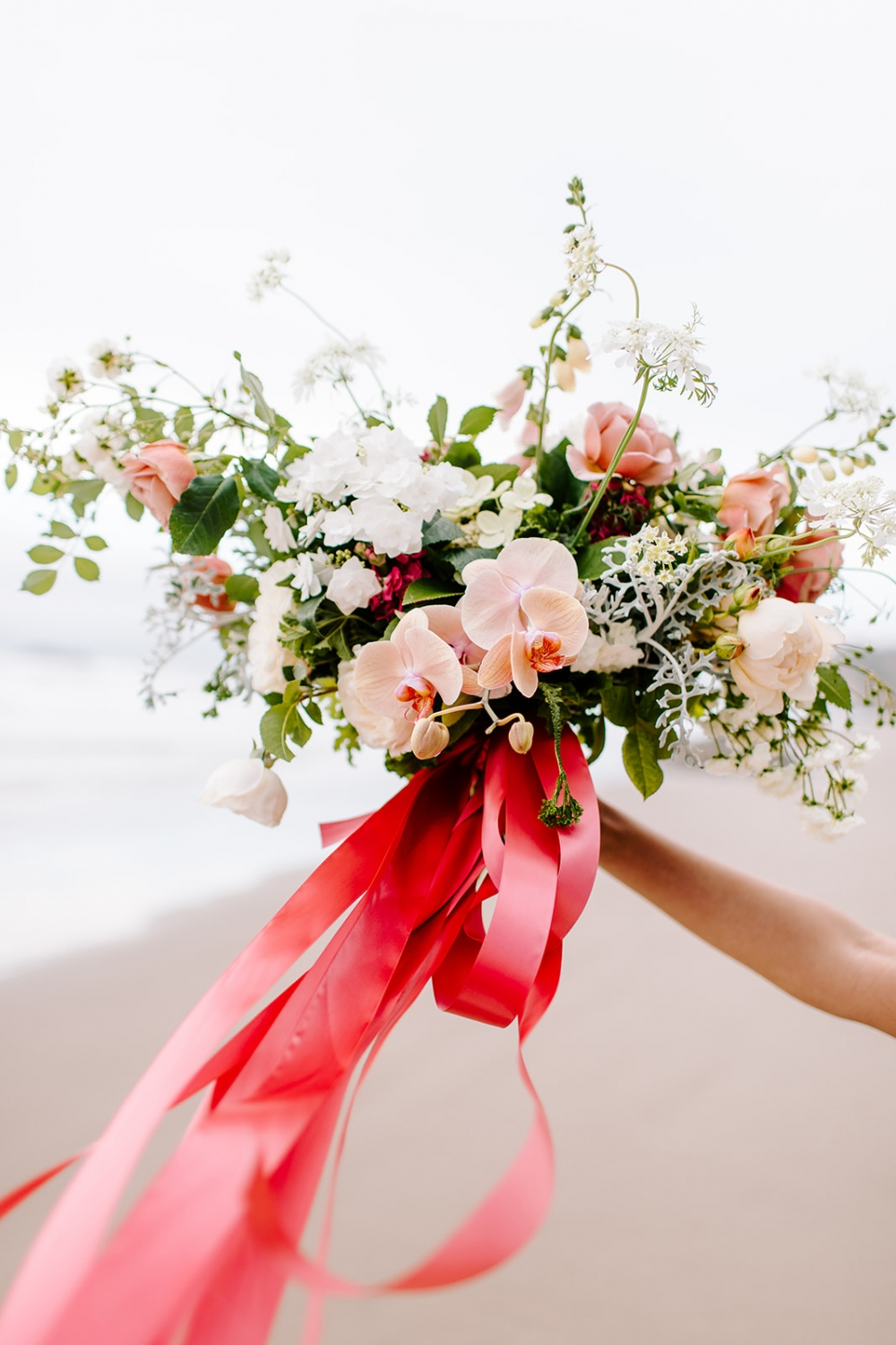 floral bouquet with coral ribbon
