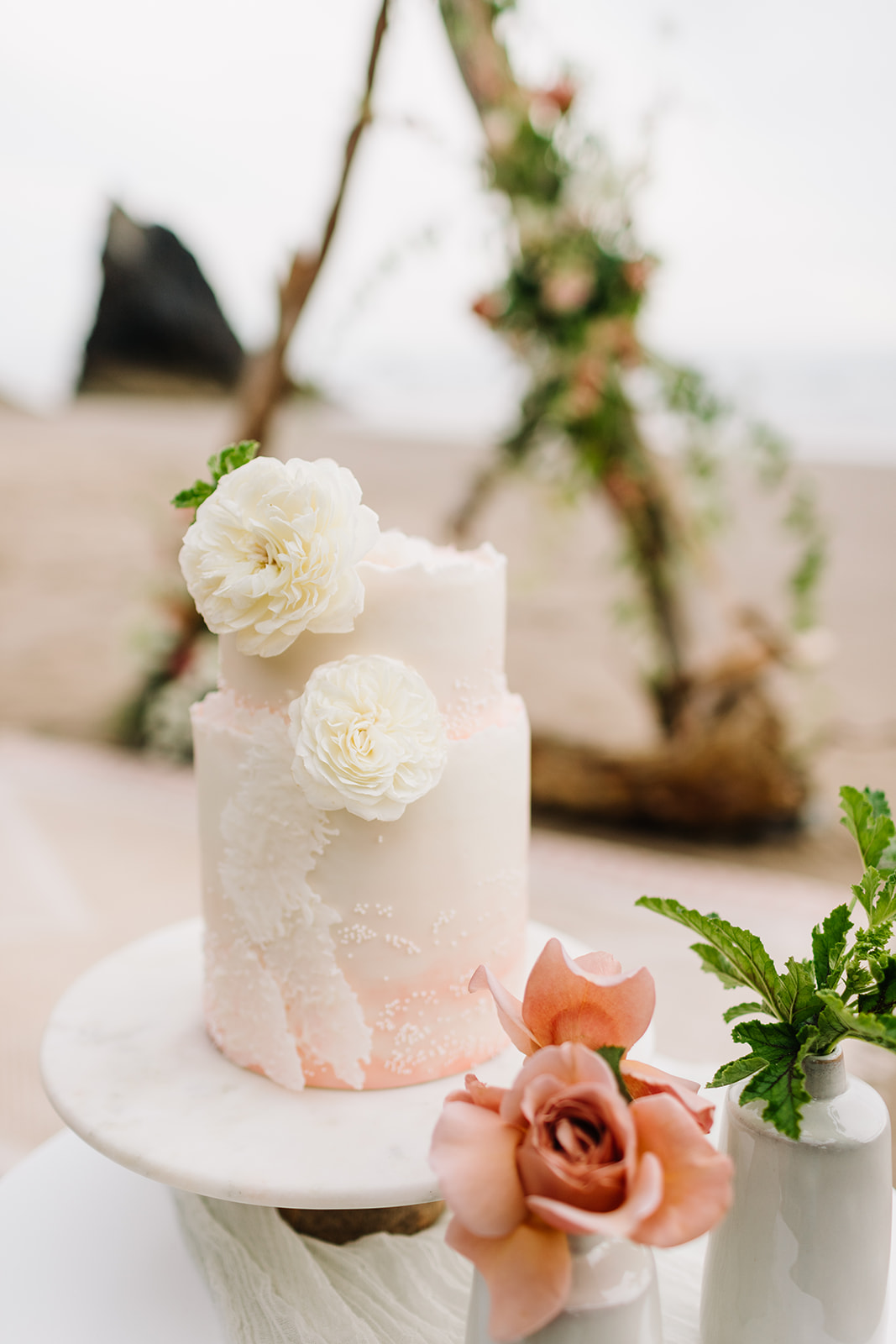 white beach wave cake decorated with flowers