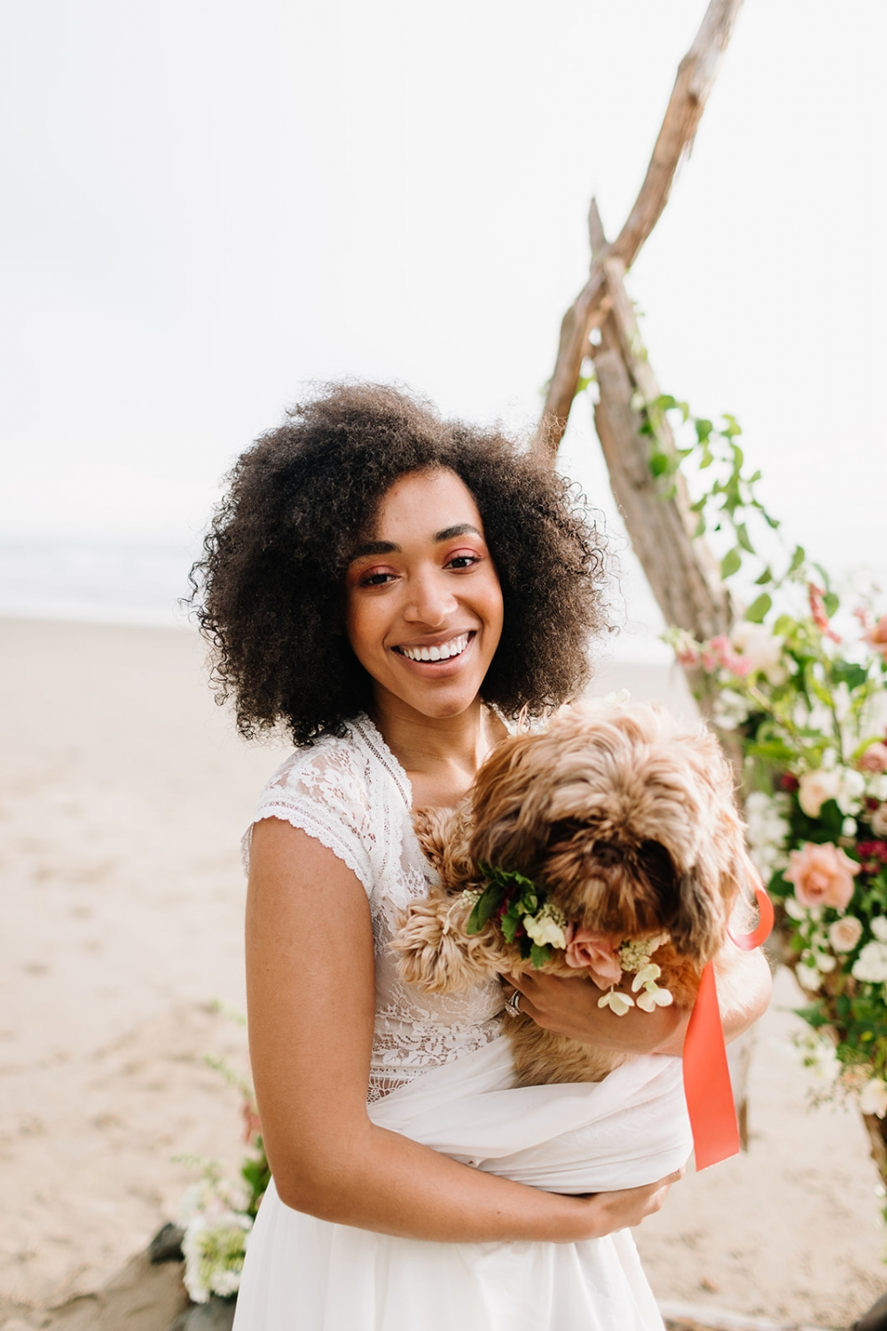 bride holding a dog of honor
